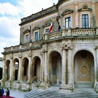 Main square of Noto, Italy with the town hall (Palazzo Ducezio).