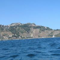 A view of Taormina from the bay of Giardini Naxos