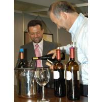 George offering wine tasting